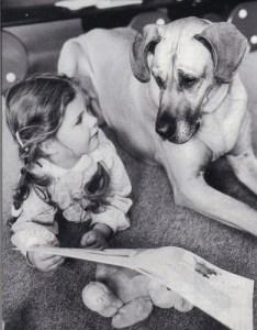 Girl Storytelling to Dog