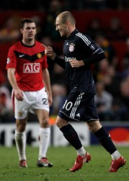 Arjen Robben of Bayern Muenchen celebrates  scoring his team's second goal during the UEFA Champions League Quarter  Final second leg match between Manchester United and Bayern Muenchen at  Old Trafford on April 7, 2010 in Manchester, England.