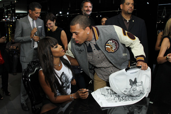 Naomi Campbell (L) and singer Chris Brown attend the Dolce & Gabbana celebration of Fashions Night Out at Dolce & Gabbana Boutique on September 10, 2010 in New York City. (September 9, 2010 - Photo by Neilson Barnard/Getty Images North America)