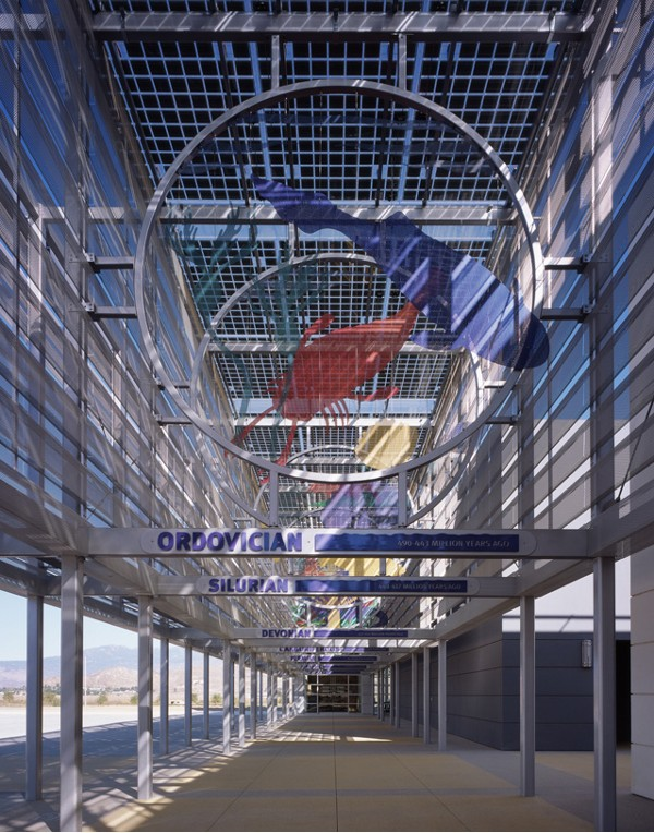 Colored, perforated steel identifies eras of pre-history