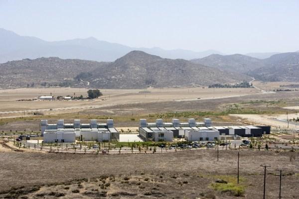 Ten steel monoliths blaze across the desert sky
