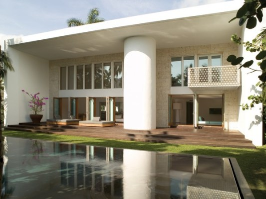 Tremendous spaces with oversized windows overlook the pool and canal.