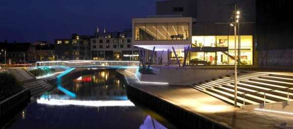 A view to the theatre and bridge at night
