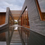Reflecting pool at the end of the orchid lined exterior corridor (Images Courtesy Benny Chan)