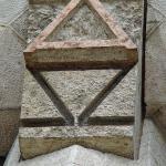 Alpha and Omega carving at Sagrada Família entrance : Image Courtesy Antoni Gaudi