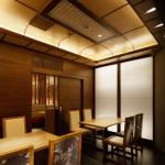 Private room. Japanese traditional architectural method is used to make the ceiling. Kimono cloths are used at the back of the chairs. Set of four chairs make one design, Image Courtesy © Satoru Umetsu, Nacasa & Partners Inc.