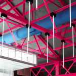 Image Courtesy © Anagrama, Neon painted roof beams and stage detail