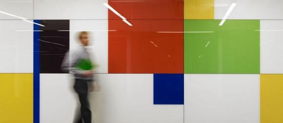Laminated Glass was chosen for all wall surfaces to be writable and reflective.  Employees are encouraged to literally write on walls and problem solve in real time, Image Courtesy © Rossetti Architects