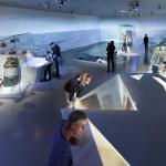 Theme Navigation, show cases shaped as icebergs with projections of seascapes on the wall, Image Courtesy © Thijs Wolzak