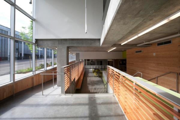 View of entrance screen, featuring generous daylighting, LED lights, local concrete, and local, FSC-certified wood. - Photo Credit: Sally Schoolmaster