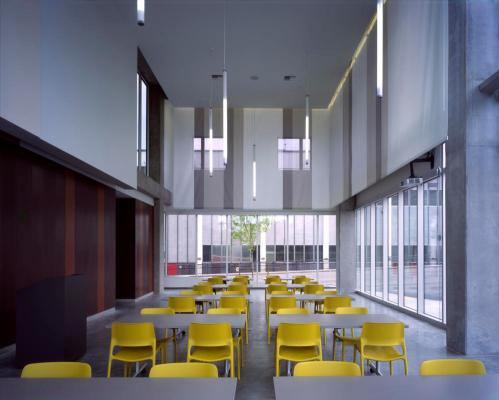 Bud Clark Commons' community room, featuring generous daylighting, LED lights, and local concrete. - Photo Credit: Sally Schoolmaster