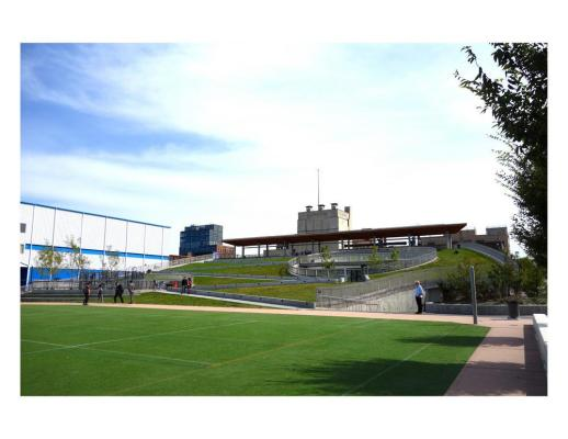 Building from sports field - Photo Credit: Kiss + Cathcart, Architects