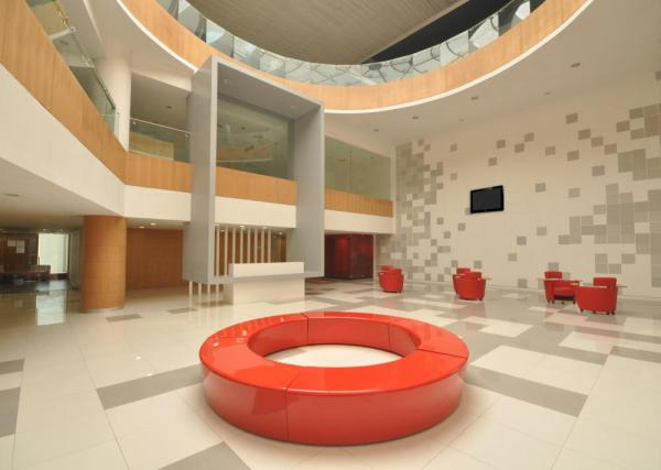 Naturally lit triple height Reception Area, Image Courtesy © ABIN DESIGN STUDIO