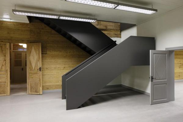 new staircase in the central hall, Image Courtesy © Ansis Starks