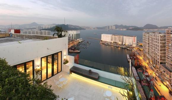 Roof view of terrace with the harbour and Kowloon in the background, Image Courtesy © Laboratory for Explorative Architecture & Design Ltd