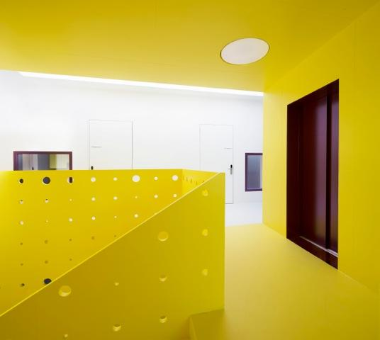 Stairway and bright corridor in center of first floor, Image Courtesy © Christian Senti