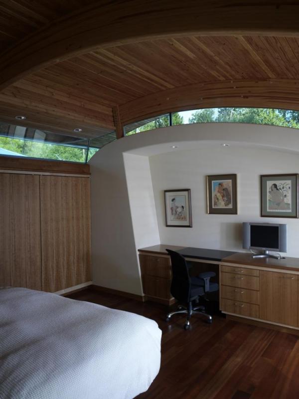 The Guest Bedroom with desk and closet, Image Courtesy © Robert Harvey Oshatz, Architect