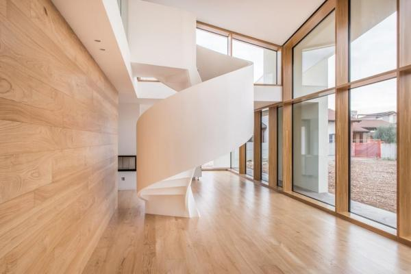 The home's two levels are connected by a prefabricated staircase , Image Courtesy © Alessandro Ruzzier
