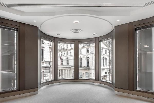 In the office areas, service ducting and ceiling detailing have been changed throughout, Image Courtesy © Jan Piotrowicz