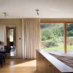master bedroom – sliding picture window & glazed doors to the lower garden level, Image Courtesy © Paul Tierney