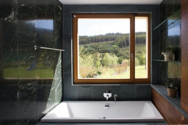 bathroom window – framed view of the hillside beyond, Image Courtesy © Paul Tierney