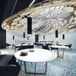 Main Hall_handmade luminaries lightly levitates above the main space, Image Courtesy © Alfonso Calza