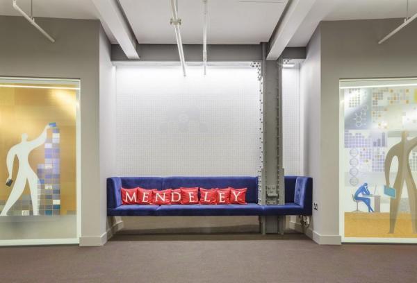 Nook with royal blue velvet sofa in lift lobby area, Image Courtesy © Gareth Gardner
