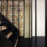 Detail of steel staircase against the exposed brick wall , Image Courtesy © H. Lin Ho