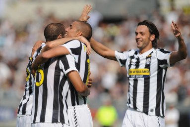 David Trezeguet (C) of Juventus FC celebrates his goal with Giorgio Chiellini (L) and Nicola Legropttaglie (R) during the Serie A match between Juventus FC and Bologna FC at Olimpico Stadium on September 27, 2009 in Turin, Italy.