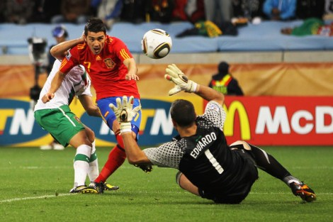 David Villa of Spain scores his side's first goal past Eduardo of Portugal during the 2010 FIFA World Cup South Africa Round of Sixteen match between Spain and Portugal at Green Point Stadium on June 29, 2010 in Cape Town, South Africa.