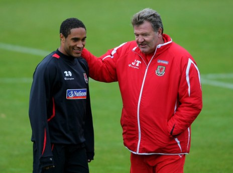 Wales manager John Toshack (R) chats to Ashley Williams during Wales Football training at the Vale Hotel on October 7, 2008 in Cardiff, Wales.