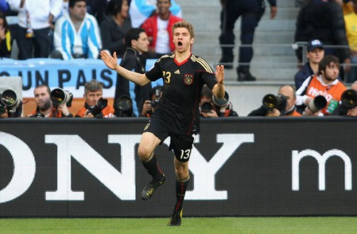 Thomas Mueller of Germany celebrates scoring the opening goal during the 2010 FIFA World Cup South Africa Quarter Final match between Argentina and Germany at Green Point Stadium on July 3, 2010 in Cape Town, South Africa.