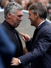 Manchester City Manager Roberto Mancini (R) greets Chelsea Manager Carlo Ancelotti prior to the Barclays Premier League match between Manchester City and Chelsea at the City of Manchester Stadium on September 25, 2010 in Manchester, England.