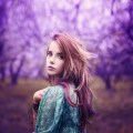 beautiful girl in a vintage style in a fabulous purple park