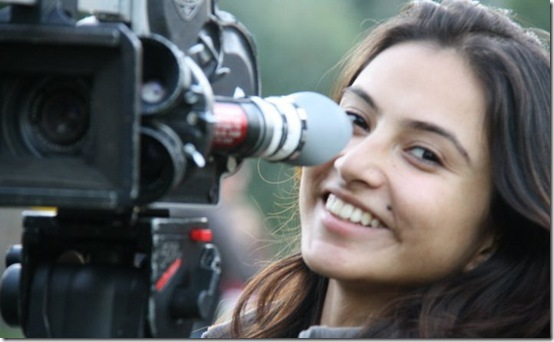 nisha smile-behind camera