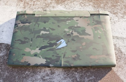 The lid of the laptop is a good place to start as any, with a fine display of the MultiCam camouflage.