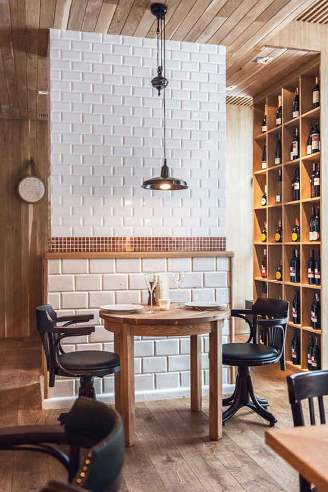 Althaus Restaurant, dining room, white tiles, wine rack, timber ceiling