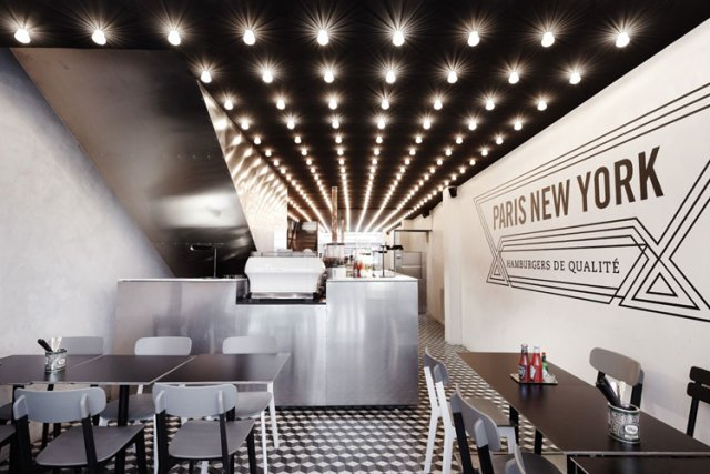 PNY restaurant interior, wall graphic, black ceiling, light bulbs on grid