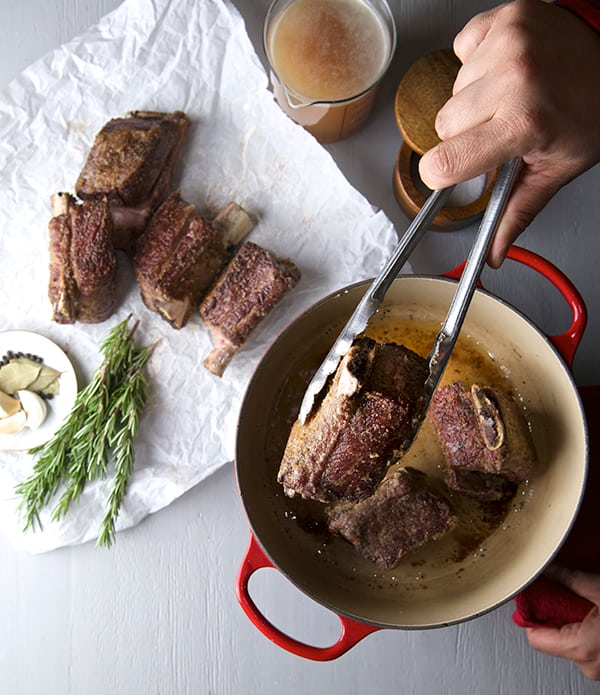 ... the seared short ribs, bone side down into the pan on a single layer
