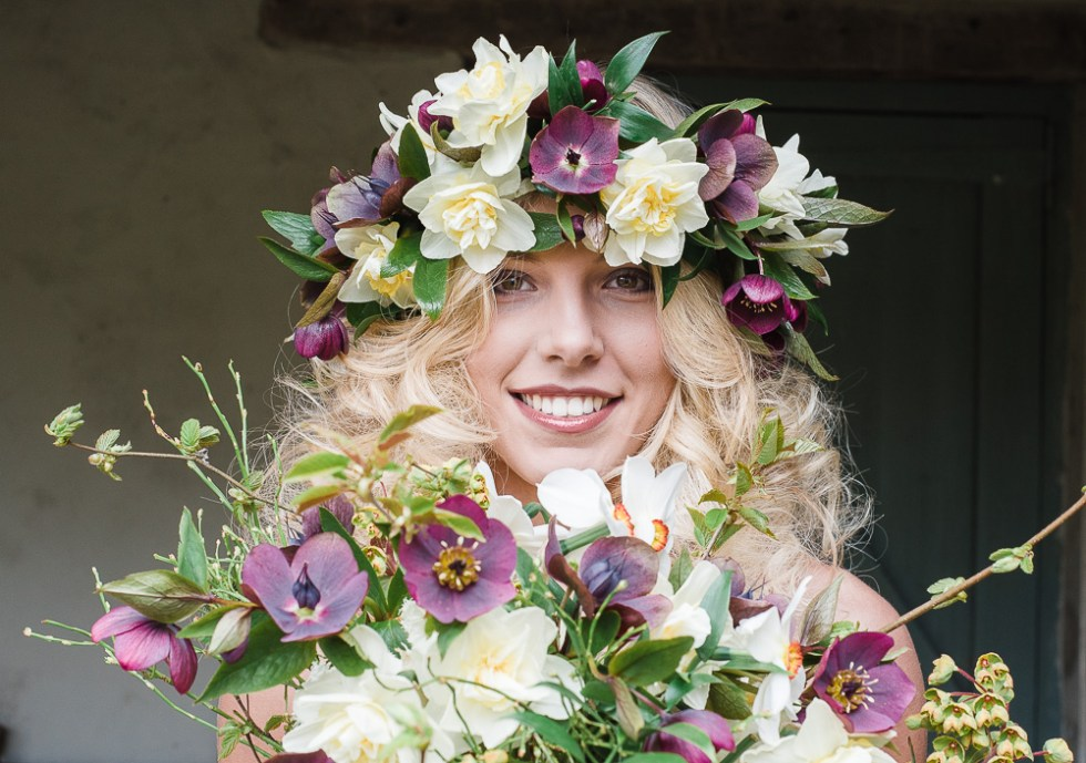 Model Katie Holmes wearing a floral crown made from Hellebores and Narcissi.