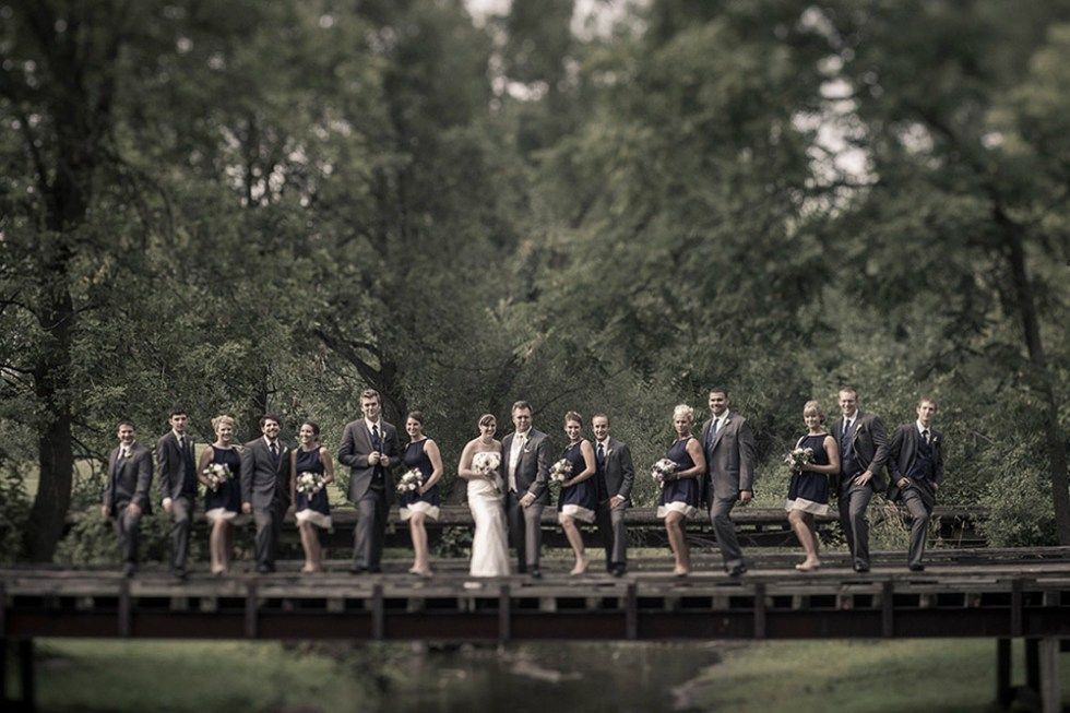 Bridal party on a bridge