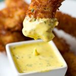 Coconut Crunch Chicken Strips with Creamy Honey-Mango Dipping Sauce