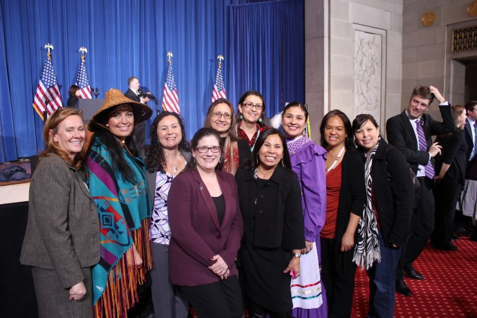 The National Indigenous Women's Resource Center staff and other Native women working to end violence against Native women pose at the February 2008 Violence Against Women Act (VAWA) Reauthorization in Washington, D.C. just after President Obama signed the act into law.