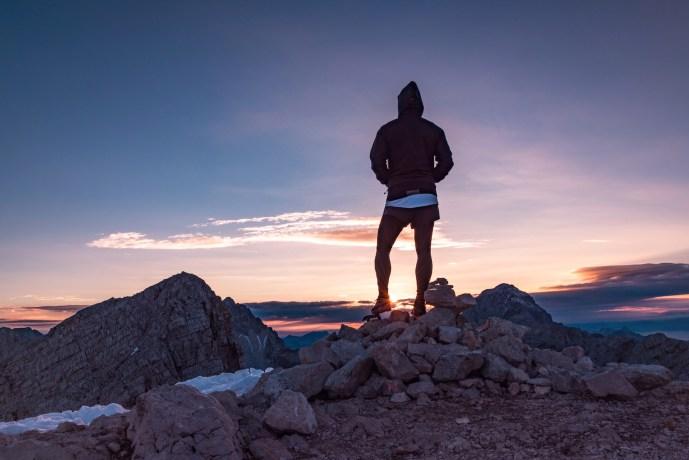 woman-atop-mountain-stock