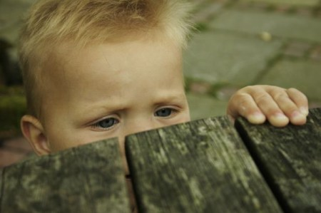 eyes-child-behind-wood