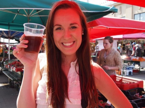 Alexa Rae of the travel blog, Zaagi Travel, posing with a glass of Kvass in Riga, Latvia during the summer of 2013 via ZaagiTravel.com