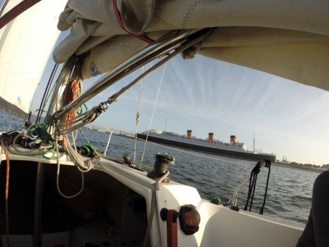 The Queen Mary from a sailboat in Long Beach, California just before sunset