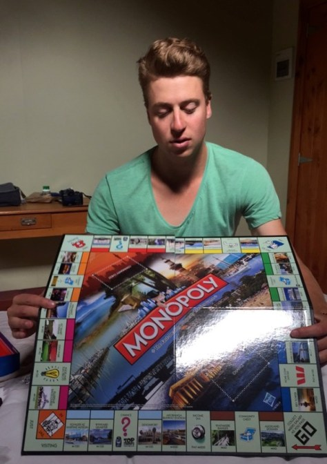 Playing Monopoly with James in the Coromandel, New Zealand via ZaagiTravel.com