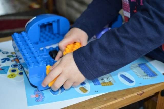 Girl Building peppa pig boat