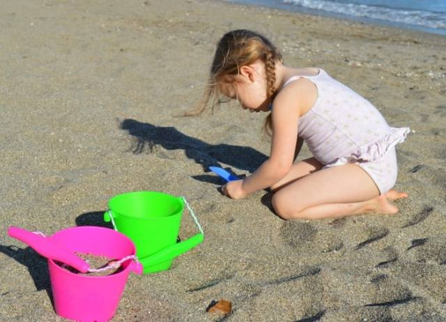 playing with bucket and spade on the beach